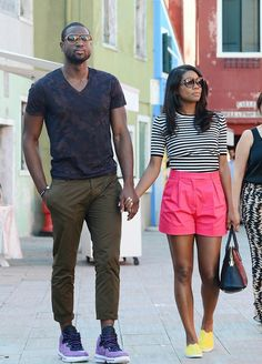 Gabrielle Union. Yellow shoes, pink shorts, loose shorts, striped shirt, black purse. Summer spring outfit