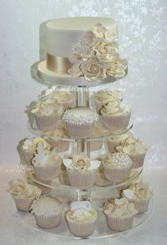 Ivory and White Wedding Cupcake Tower  I want something like this for our vow renewal