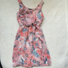 EUC Chiffon w ruffles dress Excellent used condition! Chiffon dress with ruffles on the top as shown in second picture. Floral print in a beautiful light pink color with white and blue.  Does have a lining.  Cinches at the middle to accentuate waist. Also has two loops for a belt to accentuate the waist, does not come with belt. 100% polyester.  Purchased from Nordstrom rack Socialite Dresses