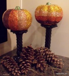 Some seasonal pumpkins and rainbow glitter is all you need to create these Ombre Glitter Pumpkins!