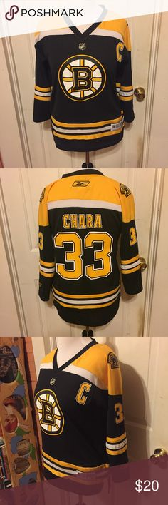 NHL Bruins Hockey Jersey Chara #33 Youth L/XL NHL Bruins Hockey Jersey Chara #33 size Youth L/XL. Would work great for a L/XL Woman as well. Made by Reebok. Comment if you need measurements. There is one fabric pull as pictured red and a tiny red mark on one sleeve. Otherwise in great condition. Mannequin is a size 12/14 Woman. Bundle and Save $! All my listings are crossposted on multiple sites. Reebok Other