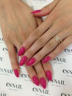 Hot pink almond shaped nails