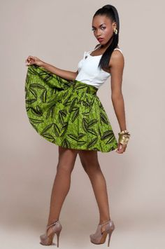 This lady looks chic in the green ankara skirt and white vest! African Dresses For Women, African Attire, African Wear, African Women, African Clothes, African Style, African Beauty, African Inspired Fashion, Africa Fashion