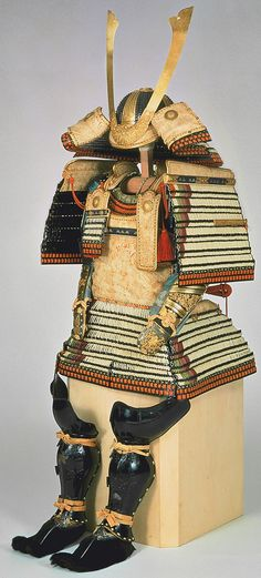 Ōyoroi-type armor (replica), white cord lacing with diagonal corner accents (tsumadori), replica of a suit worn by Hosokawa Yoriari (1332–1391), Japan. Edo period, 1829 (after 14th century original). Iron, gilt bronze, metal, tooled leather, lacquer, braided silk, fur. Eisei-Bunko Museum.