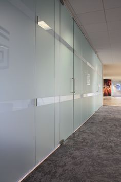 #Glass #partitioning walls going down either side of the entrance corridor