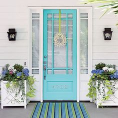 I'd love to come home after work and see this warm and cute baby-blue door