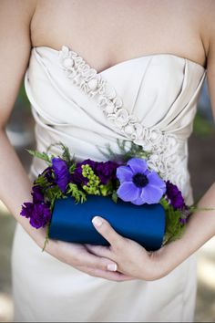 """Clutches instead of bouquets has become quite popular; bridesmaids can carry plain clutches, while the bride can carry a clutch with flower embellishments."""