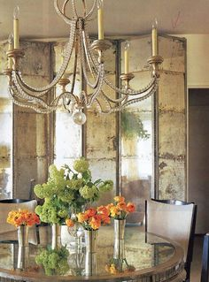 Rustic mirrored room divider and round dining table, vintage chandelier decorating with metal gold silver copper iron mirrored furniture