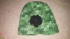 Simple green hat with a flower. All of it is crochet. Winter will be here before you know it. One size fits most.