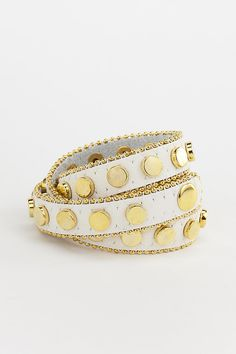 Dressing Your Truth - Type 1 Money Trail Bracelet     This wrap around style bracelet features a trail of gold colored studs along a white leather band trimmed in a tiny gold bead trim.        23 inches long      Two snap adjustment