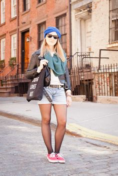 Chelsea resident Coline Gautier, an interior designer, rocks a pair of tights underneath her denim shorts for an extra layer. She also wears a Lana Siberie hat, H&M jacket, Comptoir des Cottoniers scarf and Vans sneakers.