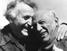 Beautiful photo of artists, Marc Chagall and Pablo Picasso, laughing together in their elder years. (1941)