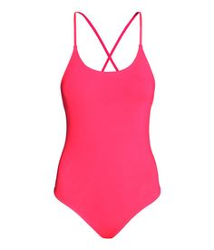 Lined swimsuit. Narrow, adjustable shoulder straps tie in various ways at back. Punchy neon coral pink. | H&M Swim