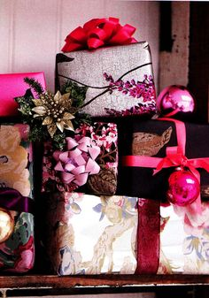 Wrappings in shades of rose, Burgundy and pinks!!! Bebe'!!! These colors are particularly festive when topped with coordinating velvet and satin ribbons!!!