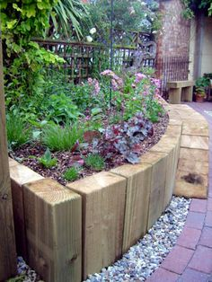 use vertical railway sleepers to create a curved wall raised beds - curved walls may work with overall design better divide between Mediterranean garden and English garden rather than original oblong med wall bed idea garden raised beds Lawn And Landscape, Landscape Edging, Small Front Gardens, Back Gardens, Garden Cottage, Garden Beds, Sloped Garden, Garden Posts, Garden Benches