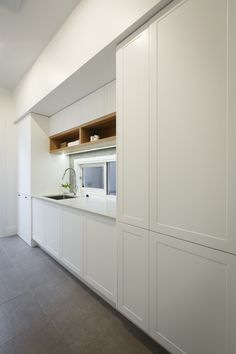 Luxe laundry featuring white Shaker cabinetry and open timber shelving from Freedom Kitchens.  By winners Josh & Elyse.