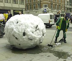 Snowballs Great balls of snow Workmen sweep around a giant snowball near the Barbican, central London. British sculptor Andy Goldsworthy has made 13 similar snowballs which melt over time to reveal objects such as sheep's wool and chesnut seeds he has collected from the Scottish highlands.