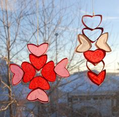 Valentine sun catchers made with empty toilet paper rolls.