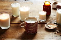 A tall pour of melted soy wax turns any heat-proof glass or mug into a candle—and it couldn't be easier. #candlemakingcontainers