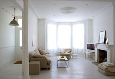 Living Room White Wall Paint Decoration Wooden Laminate Flooring Picture Above Concrete Mantle Shelf Of Fireplace Grey Sofa Upholstered Chair Cushions Flowers Appealing Inspiring Basic White Living Room Design Small Living Room Decor, Room Design, Interior, Home, Living Room White, Small Living Room, Room Inspiration, House Interior, Interior Design