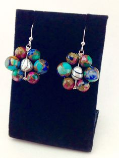 A personal favorite from my Etsy shop https://www.etsy.com/listing/512507009/colorful-earringssterling-silver