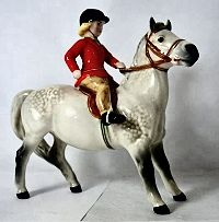 Rare Beswick Girl with Red jacket on Grey Pony 1499 (good restoration to one back leg). (1kq)