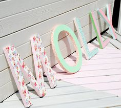 Wooden letters decorated with pretty printed tape... cute!