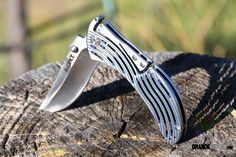 CRK5265: Tighe Rod Brian Tighe Design. Thicker, stainless steel handle scales are attractively skeletonized to reduce weight without sacrificing strength. Titanium Nitride coated blue and then surface finished to create a visually striking color effect.  http://www.osograndeknives.com/store/catalog/knives/columbia-river-crkt-tighe-rod-flipper-knife-satin-plainedge-5265-25218.html