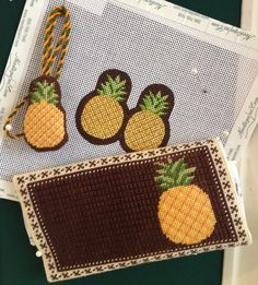 Pineapple Needle case and scissor finder in needlepoint by Kirk & Bradley. Photo- needlepoint.com