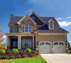 Great curb appeal-love the siding/stone & garage doors