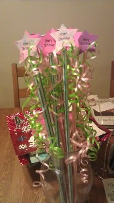 Made these for a craft fair during the holidays.  They are pixie sticks with a star on top that say Merry Christmas with curling ribbon tied around them.  They were super popular with all the kids.