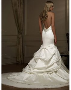 I love the back but would have the skirt straight without the pick ups.. Sexy Satin Halter Beading Mermaid Wedding Dress