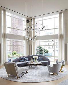 floor-to-ceiling windows, mod velvet furniture + an eclectic light fixture...swoon