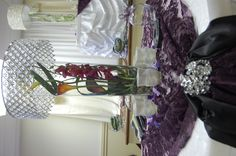 Purple orchid, Hot Orange cala and Spicey yellow cala are the perfect modern combination for this crystal shade centerpiece.