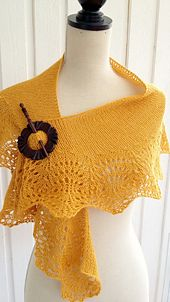 A quick and light knit, this crescent shaped shawlette has a lacy edge and is worked from the bottom up.