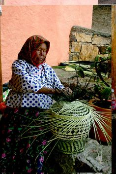 Tarahumara woman weaving a basket in Pitorreal