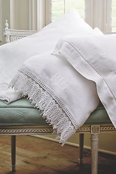 Monogrammed Vintage Pillowcases -- I'm OBSESSED with finding white vintage linen pillowcases especially if they have monograms! I learned the way to clean them (process of about 2 days) so they're soft as can be... And clean!