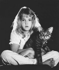 Drew Barrymore back in her E.T. days. Once a cat person always a cat person.