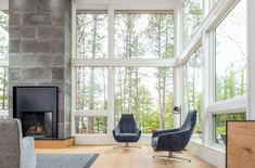 Modern living room with glass walls and fireplace