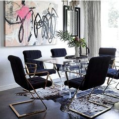Glam dining room with abstract art. My kind of space.