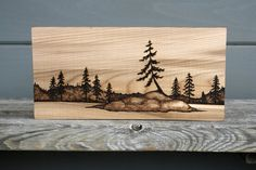 Add a touch of outdoors to your living space with this nice little decor piece, natural wood with black scenic sketch