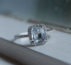1.2ct cushion white to ice blue sapphire diamond ring 14k white gold from eidelprecious on etsy. all of her rings are perfect.