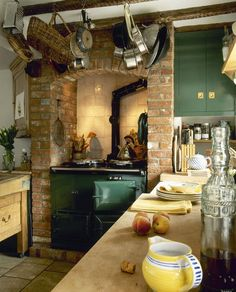 Rustic green & brick kitchen.