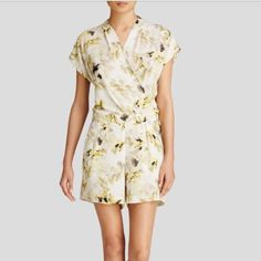 🎉2 HOUR HOST PICK SALE! 🎉Floral Romper - NWT •Floral romper crafted in a lightweight fabrication.  •Surplice V-neckline.  •Short sleeves. •Fitted waist.  •Concealed front snap closure.  •Side hand pockets; faux back welt pockets.  •100% polyester.  •Machine wash cold, tumble dry low. •Imported. •Measurements: • Inseam: 4 1⁄2 in DKNY Pants Jumpsuits & Rompers