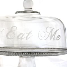 Eat Me- Cake plate with dome, Alice in Wonderland. Etched Glass cake stand, dessert tray, cake plate with lid. $65.00, via Etsy.