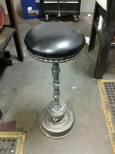 Car parts bar stool! When we get a welder i can totally do this!!
