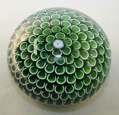 Beautiful green paper weight - perfection in glass... mmm.. Saint Louis, Harmony .1988. Green millefiori canes laid in concentric circles, with the signature cane SL 1988 in the center. Edition size of 400. Sold for £600