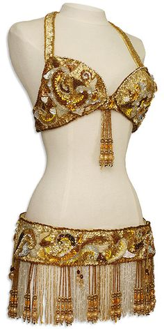 Belly dance costume (Pinning it because I like the use of larger beads in the fringe)