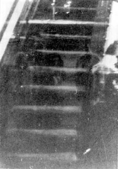 The Hull House, Chicago - built in 1856 was reportedly known for its ghosts - this photo is said to show monk-like figures on the staircase including ghostly candles