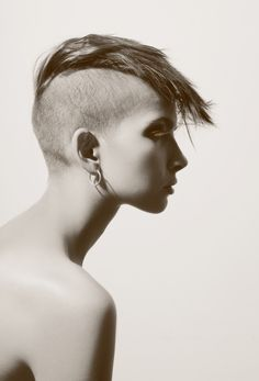 shaved sides, quasi-hawk, gorgeous lady. love.